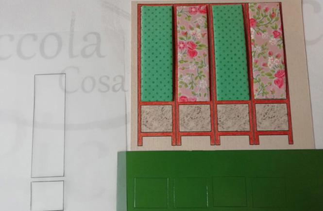 Los cuatro rectángulos del biombo ya están tapizados. Se calcan las otras cuatro partes cuadradas del biombo en una cartulina verde.
